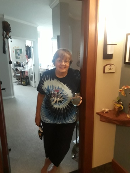 """Eden Prairie Senior Living resident says """"cheers"""" to a personal happy hour."""